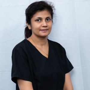 Nitasha, the Dental Assistant at Sandhurst Family Dental Clinic, stands smiling in front of a white backdrop.