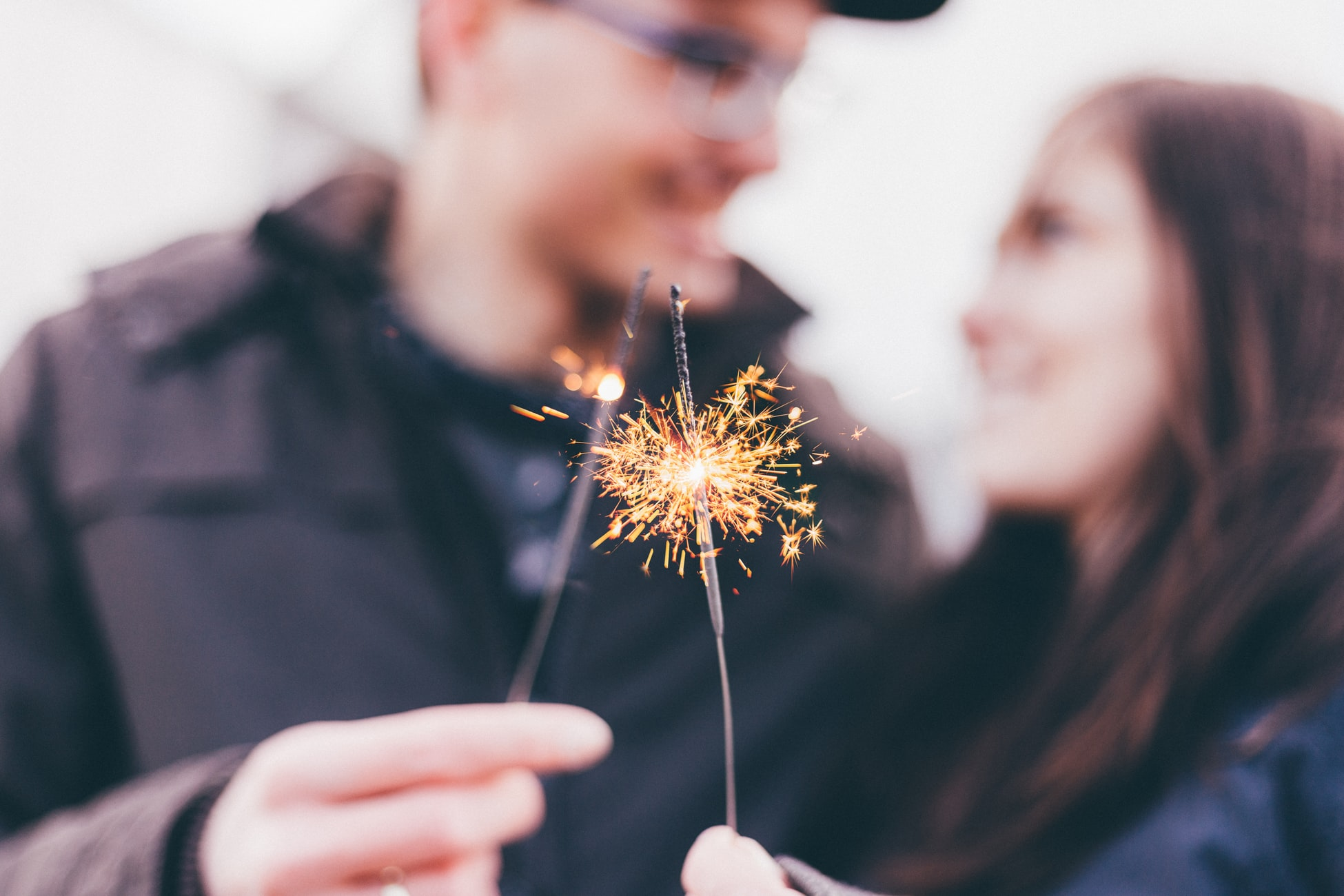 smiling couple holding sparklers