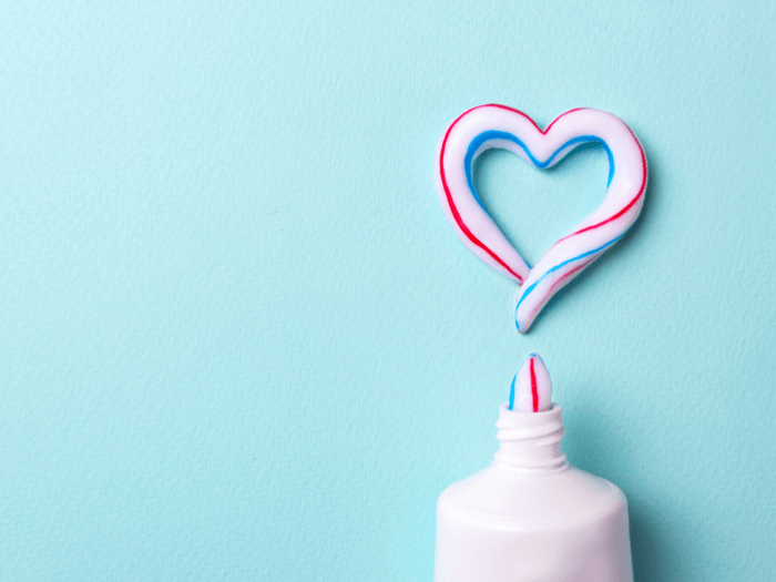tube of toothpaste drawing a heart
